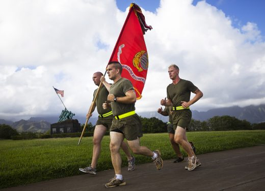 U.S. Marines with 3rd Marine Regiment run past the Pacific War Memorial with their regimental battle colors on Marine Corps Base Hawaii, Nov. 6, 2012, in celebration of the Marine Corps' 237th birthday, Nov. 10. Both Marines and Navy corpsmen assigned to 3rd Marines, the highest-deployed Marine infantry regiment in Operations Enduring and Iraqi Freedom, honored their heritage by running a two-mile course from the 3rd Marines headquarters to the Pacific War Memorial and back. In total, 29 teams of four runners and an additional lone runner completed 237 miles.